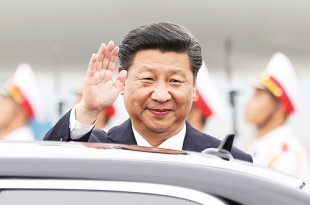 Chinese President Xi Jinping waves as he arrives at Noi Bai International Airport in Hanoi, Vietnam. Xi's visit to Vietnam last Thursday came as the two communist countries seek to mend ties strained over territorial disputes in the South China Sea. AP