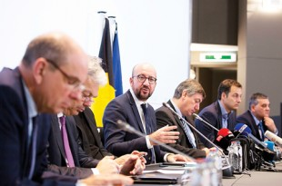Belgian Prime Minister Charles Michel, center, addresses a media conference, in Brussels, on Saturday, Belgium raised ist security level to its highest degree on Saturday as the manhunt continues for extremist Salah Abdeslam, who took part in the Paris attacks. APairlines