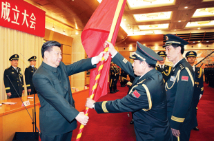 Chinese President Xi Jinping hands over a military flag to Wei Fengh, commander of the Rocket Force of the Chinese People's Liberation Army (PLA), and Wang Jiasheng, political commissar of the Rocket Force, in Beijing. China has created three new military bodies as part of reforms to modernize its military - the world's largest standing force - and improve its fighting capacity. AP