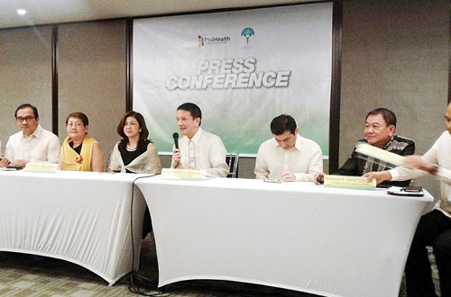 Philippine Health Insurance Corp. President Alexander A. Padilla (fourth from left) speaks during a press conference marking the agency's 21st anniversary. PNA