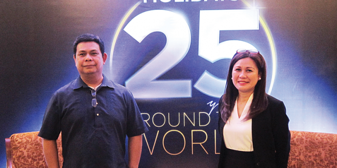 Profil Holidays's Bong Tabang (left) and Rosanna Inciong pose for a picture at the press conference on the company's 25th anniversary at the Manila Hotel on Mar. 8. ALVIN I. DACANAY