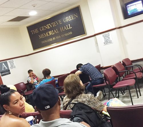 waiting room in a New York infirmary—note the wall TV, on which a drama series entertains patients