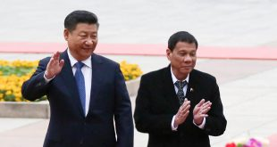 China's President Xi Jinping (left) and President Duterte acknowledge greeters in one of their several public appearances in Beijing. (Photo: PNA)