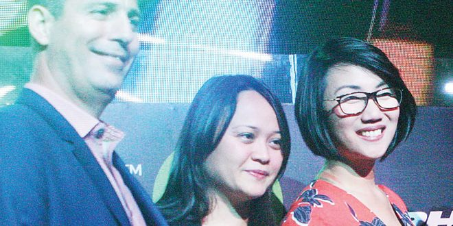 Exceed Sports and Entertainment co-founder and Chief Executive Officer Martin Capstick (left) is joined by Philam Vitality Deputy Head Kats Cajucom (center) and Alcatel Country Manager Charlotte Koa during the recent launch of The Music Run at the Revel at the Palace in Makati City. REYMUNDO G. NILLAMA