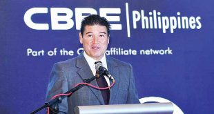 This November 2015 photo shows CB Richard Ellis (CBRE) Philippines Inc. Chairman Rick M. Santos speaking at an event in Fairmont Hotel in Makati City. CBRE PHILIPPINES FACEBOOK PAGE