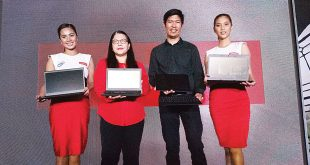 Lenovo Philippines Marketing Manager Anna Abola and Commercial SMB 4P Manager Francis Judan (second and third from left, respectively) join two Lenovo models in holding the newest 7th Generation Kaby Lake-powered additions to the company's ThinkPad line of laptops during their launch at the Discovery Primea hotel in Makati City on March 15. ALVIN I. DACANAY