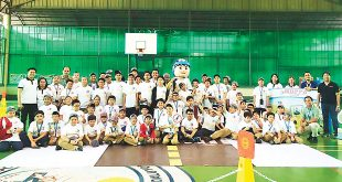 Students from Lourdes School of Mandaluyong pose for a photo with Motorcycle Development Program Participant Association Inc. (MDPPA) representatives and mascot Rody.