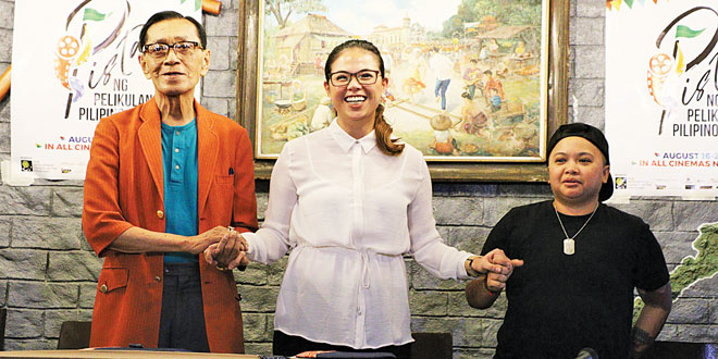 (From left) Movie and Television Review and Classification Board (MTRCB) Vice Chairman Emmanuel Borlaza, Film Development Council of the Philippines (FDCP) Chairman and CEO Liza Diño, and National Youth Commission (NYC) Chairman Aiza Seguerra hold hands in a show of unity during a press conference at Salu restaurant in Quezon City on May 12, 2017. (Photo: Alvin I. Dacanay)