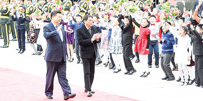 President Duterte and Chinese President Xi Jinping greet well-wishers prior to their bilateral meetings at the Great Hall of the People in Beijing on October 20, 2016.