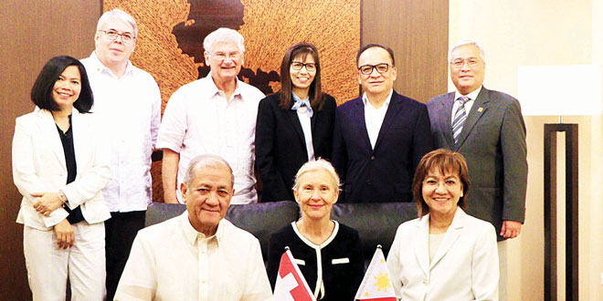 Swiss Ambassador Andrea Reichlin (seated, middle) asked the Philippine-Swiss Business Council of the Philippine Chamber of Commerce and Industry to help facilitate ratification. Seated (from left) are PCCI Chairman and Ambassador Benedicto V. Yujuico, Reichlin, and Trade Undersecretary Nora K. Terrado. Standing (from left) are Melanie Zoref of the Swiss embassy, council board members Luis Mendez (chairman) and Annie Mascenon (vice chairman), and Benjamin Los Baños.