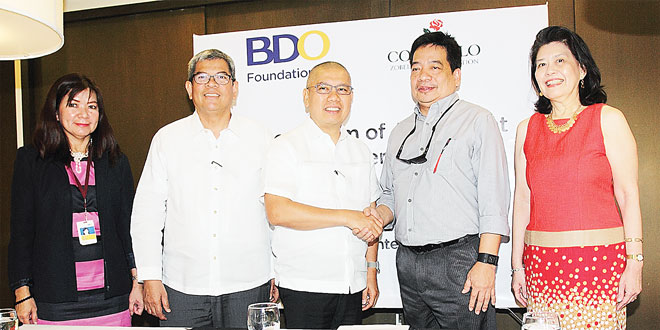 BDO Foundation and Consuelo Foundation officials pose for photos after signing an agreement for the construction of new school buildings for Mondragon Agro-Industrial High School in Northern Samar province—a project that is expected to benefit hundreds of students.