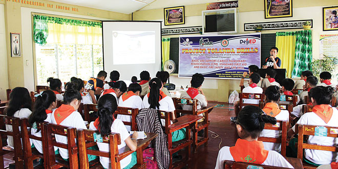 Students of the Isabel National Comprehensive School (INCS) listen to a lecture on disaster-risk reduction and drills to follow during disasters given by Pasar Foundation Inc.