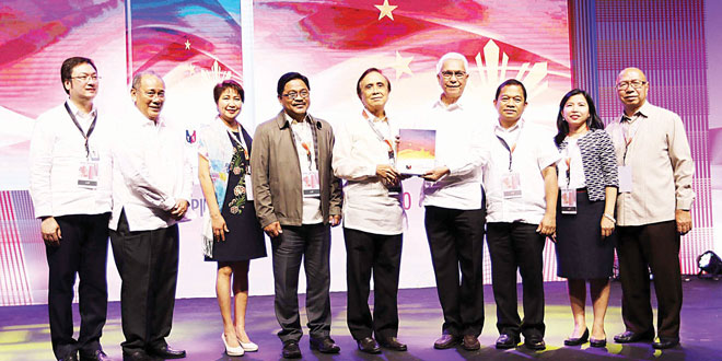 National Economic and Development Authority (Neda) Director-General Ernesto Pernia (center) hands over a copy of the Philippine Development Plan 2017-2022, the blueprint for the country's development under the Duterte administration, to Cabinet Secretary Leoncio Evasco Jr. during its launching at the SMX Convention Center in Pasay City on June 2, 2017. Also in photo (from left) are Assistant Secretary Carlos Abad Santos, Presidential Spokesperson Ernesto Abella, Undersecretary Rosemarie Edillon, Agrarian Reform Secretary Rafael Mariano; Undersecretary Adoracion Navarro and Undersecretary Jose Miguel dela Rosa. PNA