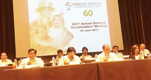 Philex chairman Manuel V. Pangilinan (middle) presides over the Philex Mining Corp.'s annual stockholder's meeting.