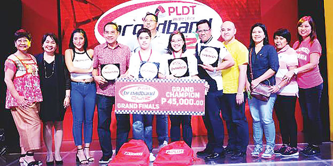 (Standing sixth from left) Rose Pauline Cotejo is hailed as the grand champion in the Teacher's category. With her are (from left) Philippine Long Distance Telephone Co. (PLDT) Community Relations Head/Consultant Evelyn M. del Rosario, UP Open University Chancellor Dr. Melinda dP. Bandalaria, GMA artist Rita Daniela, Information Technology Officer (ITO) Emmanuel Mendoza, teacher Rogel Aro, Juan Pamplona National High School Principal Clavel Salinas, Rep. Arlene Buot of Cebu province's Carmen town, and Assistant Schools Division Superintendent Roseller Gelig.