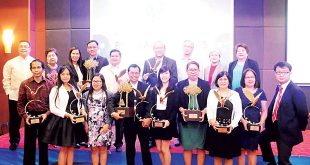 Neda Regional Office IV-A (Calabarzon) and IV-B (Mimaropa) officials display the BSP's Golden Eagle award