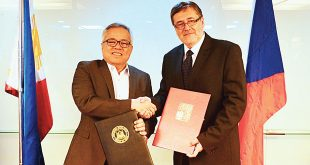 Trade Secretary Ramon Lopez (left) and Czech Ambassador to the Philippines Jaroslav Olša Jr. pose with their signed economic cooperation agreement at the Board of Investments (BOI) main office in Makati City on July 31, 2017.