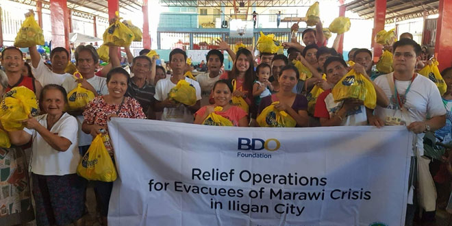 As part of relief operations organized by the BDO Foundation, volunteers from Roman Catholic organization Ako ang Saklay Inc. distributed relief goods to thousands of people affected by the Marawi crisis, as well as police and military personnel stationed in the city.