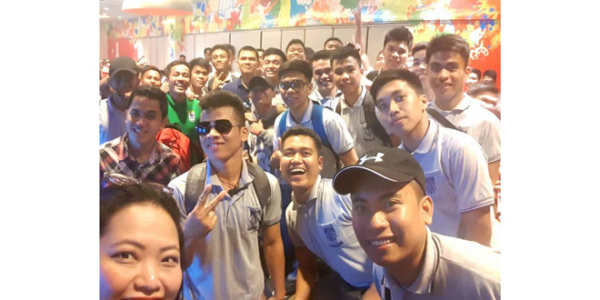 The SM Foundation Inc.'s Dualtech technical/vocational scholars pose for a groufie after they watched the latest Transformers movie at the SM Mall of Asia.