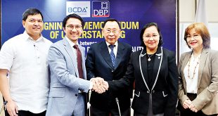 DBP President and Chief Executive Officer Cecilia Borromeo (second from right), DBP Chairman Albert Romulo (center), and BCDA President and Chief Executive Officer Vivencio Dizon (second from left) shake hands after the MOU signing. With them are DBP Senior Vice President Jose Gabino Dimayuga and BCDA Vice President and Chief Finance Officer Nena D. Radoc (far left and right, respectively).