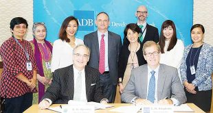 Acting Green Climate Fund (GCF) General Counsel Raul R. Herrera andAsian Development Bank (ADB) General Counsel Christopher H. Stephens (seated) pose with ADB officials during the signing of the Accreditation Master Agreement in Manila.