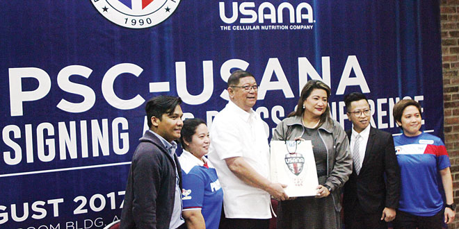 Philippine Sports Commission (PSC) Chairman William Ramirez (third from left) and USANA Philippines and Indonesia Vice President Aurora Mandanas-Gaston (third from right) seal the partnership between the two agencies in a simple ceremony at the Philsports Complex in Pasig City. REYMUNDO G. NILLAMA
