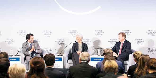 """A plenary session is held on """"Strengthening Public-Private Cooperation to Accelerate Sustainable Development,"""" (from left) chaired by W. Lee Howell, Head of Global Programming, Member of the Managing Board, World Economic Forum, with panelists Christine Lagarde, Managing Director, International Monetary Fund (IMF), Washington DC, and Feike Sybesma, Chief Executive Officer and Chairman of the Managing Board, Royal DSM, Netherlands. (WEF photo)"""