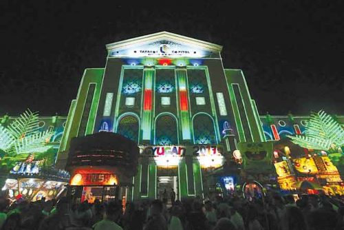 The façade of the Quezon provincial capitol building lit up and decorated during the Niyogyugan Festival.