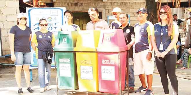 Shown are Acs Aldaba, Business Operations Head of Boracay Water (left), Chona V. Gabay, Barangay Captain of Manocmanoc (second from left), Muamar Faisal Arumpac Sitio Community leader (fourth), Engr. Jen Vergara, Technical Operations Head of Boracay Water (8th), during the donation of garbage bins in Sitio Ambulong.