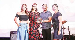 Smile Train's Country Director Kimmy Flaviano awards a plaque of recognition to Beyond Yoga's Ben Bernabe for the success of Yoga For Smiles Challenge together with ambassadors Megan Young and Aubrey Miles while a Smile Train patient turned advocate and elite runner Rojan Pajarin shares a story of his new experiences after his surgery. PHOTO BY HANANEEL BORDEY