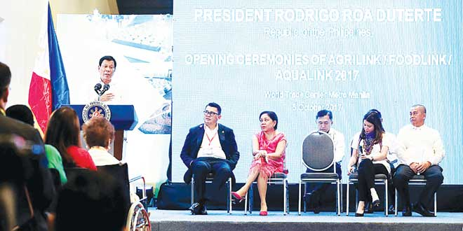 President Duterte speaks before the Agrilink/ Foodlink/ Aqualink 2017 opening ceremonies at the World Trade Center Metro Manila in Pasay City last October 5. Mr Duterte's chief economic manager Finance Secretary Carlos Dominguez III said the Philippines has started its economic breakout, turning it into one of Asia's engines of growth despite the political noise and the recent terrorist attack in Marawi City. Also in photo are Presidential Adviser for Entrepreneurship Joey Concepcion, Senator Cynthia Villar, Special Assistant to the President Christopher Lawrence Go, Agriculture Undersecretary Bernadette Puyat and Agrilink/ Foodlink/ Aqualink 2017 Chairman Candelario Miculob. PRESIDENTIAL PHOTO