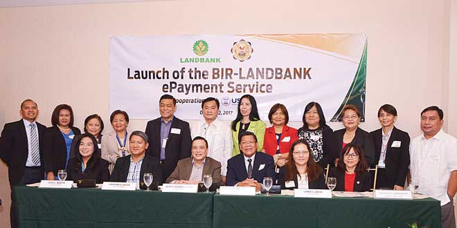 BIR Commissioner Atty. Caesar Dulay (3rd from right, 1st row) and LANDBANK President and CEO Alex Buenaventura (4th from right, 1st row) recently led the launch of the BIR-LANDBANK ePayment Service in Quezon City, joined by senior officers both from BIR and LANDBANK.