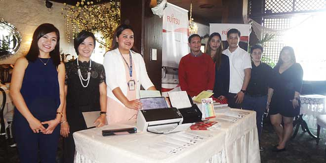 ScanSnap regional marketing head Jasmine Yeo (left) with Fujitsu Philippines personnel. (Photo by Gia Catimbang)
